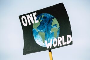 One world climate change protest painted sign